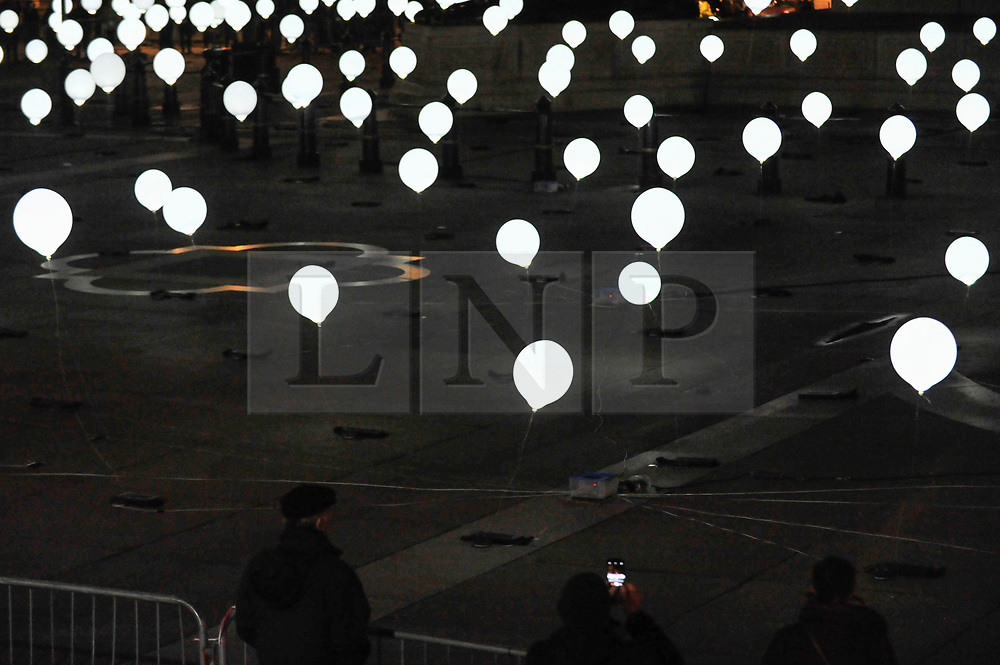 """© Licensed to London News Pictures. 18/01/2018. LONDON, UK. """"Child Hood"""" by Collectif Coin takes over Trafalgar Square which has been covered in illuminated floating balloons that turn on and off in time with accompanying music. Opening night of Lumiere London, the capital's largest arts festival commissioned by The Mayor of London and produced by Artichoke.  Light installations by leading artists have been set up, both north and south of the river for the public to view 18-21 January. Photo credit: Stephen Chung/LNP"""
