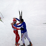 Winter Olympics, Vancouver, 2010.Dario Cologna, Switzerland, winning Gold, is congratulated by Silver Medalist  Pietro Piller Cottrer, Italy,  in the Men's 15km Cross Country Skiing event at The Whistler Olympic Park, Whistler, during the Vancouver Winter Olympics. 14th February 2010. Photo Tim Clayton
