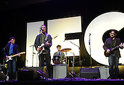 Scott Aukerman, left, Fred Armisen, center, Jefferson Dutton, on drums, and Marc Maron, right, perform at the IFC Upfront 2014 event, Thursday, March 20, 2014, at Roseland Ballroom in New York.  (Photo by Diane Bondareff/Invision for IFC/AP Images)