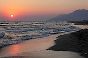 Sunset over the Mediterranean Sea at Patara Beach, an 11 mile long stretch of sand in the Turkish Riviera, Antalya, Turkey. Part of a national park, it is a key biodiversity area, rich in birdlife and the breeding ground of the endangered loggerhead turtle. Nearby are the remains of the ancient Greek Lycian city of Patara. Picture by Manuel Cohen