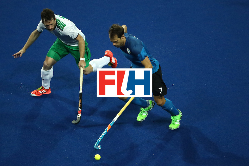 RIO DE JANEIRO, BRAZIL - AUGUST 12:  John Jackson #3 of Ireland chases Facundo Callioni #7 of Argentina during a Men's Preliminary Pool A match on Day 7 of the Rio 2016 Olympic Games at the Olympic Hockey Centre on August 12, 2016 in Rio de Janeiro, Brazil.  (Photo by Sean M. Haffey/Getty Images)