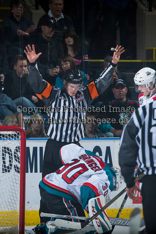 KELOWNA, CANADA - MARCH 31: Referee Reid Anderson makes a call above Michael Herringer #30 of the Kelowna Rockets against the Kamloops Blazers on March 31, 2017 at Prospera Place in Kelowna, British Columbia, Canada.  (Photo by Marissa Baecker/Shoot the Breeze)  *** Local Caption ***
