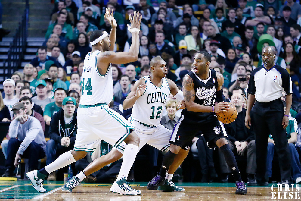 30 January 2013: Sacramento Kings shooting guard Marcus Thornton (23) looks to pass the ball over Boston Celtics shooting guard Leandro Barbosa (12) and Boston Celtics power forward Chris Wilcox (44) during the Boston Celtics 99-81 victory over the Sacramento Kings at the TD Garden, Boston, Massachusetts, USA.