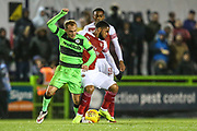 Forest Green Rovers Isaac Pearce(17) and Arsenal's Trae Coyle(70) during the EFL Trophy group stage match between Forest Green Rovers and U21 Arsenal at the New Lawn, Forest Green, United Kingdom on 7 November 2018.