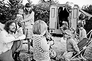 Young white family play together, all looking towards young child in the middle. Glastonbury 1992
