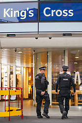 © Licensed to London News Pictures. 07/12/2015. London, UK. Armed police patrolling at King's Cross station in London on Monday, 7 December 2015. Photo credit: Tolga Akmen/LNP
