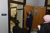 """Members of the Hyde Park Community Action Council toured the newly remodeled Canter Middle School building located at 4959 S. Blackstone Tuesday evening.<br /> <br /> 3680 – Security Staff Member, Ed Horton led the tour. He is pictured here showing one of the new office spaces.<br /> <br /> Please 'Like' """"Spencer Bibbs Photography"""" on Facebook.<br /> <br /> All rights to this photo are owned by Spencer Bibbs of Spencer Bibbs Photography and may only be used in any way shape or form, whole or in part with written permission by the owner of the photo, Spencer Bibbs.<br /> <br /> For all of your photography needs, please contact Spencer Bibbs at 773-895-4744. I can also be reached in the following ways:<br /> <br /> Website – www.spbdigitalconcepts.photoshelter.com<br /> <br /> Text - Text """"Spencer Bibbs"""" to 72727<br /> <br /> Email – spencerbibbsphotography@yahoo.com"""