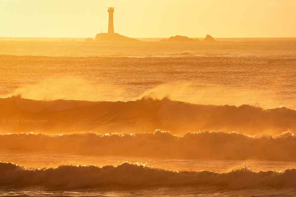 Longships Lighthouse & huge surf off Land's End, Cornwall