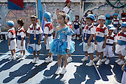 KADEEJEEN, BANGKOK, THAILAND, DECEMBER 2012:..the kadeejeen community get together to celebrate the coming holiday and children from the cattolich schools.around compite to win the annual games, Dec 2012..The Kadeejeen neighbourhood comprises six communities  Wat Kalaya, Kudeejeen, Wat Prayurawong, Wat Bupparaam, Kudee Khao and Roang Kraam...Ever since the Thonburi era (in the 17th Century), these historic neighbourhoods have maintained the diverse cultural heritage of three religions and four beliefs (Theravada Buddhism, Mahayana Buddhism, Christianity and Muslim) while coexisting in peaceful harmony...The neighbourhood is still characterised by Bangkok's traditional urbanism which is that of a fine-grained, religious establishment-centred urban structure with close-knit social cohesion. ©Giulio Di Sturco/Reportage by Getty Images.
