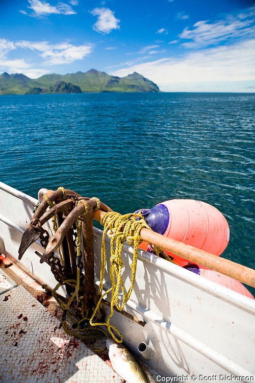 Anchors and buoys aboard a commerical halibut longlining boat fishing in the Aleutian Islands, Alaska.