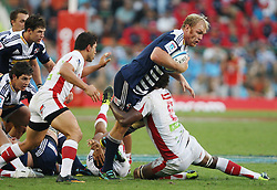 Schalk Burger of the Stormers is tackled by Radike Samo of the Reds during the Super Rugby (Super 15) fixture between DHL Stormers and the Reds played at DHL Newlands in Cape Town, South Africa on 9 April 2011. Photo by Jacques Rossouw/SPORTZPICS