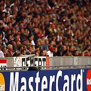 NLD/Amsterdam/20051018 - Champions League wedstrijd Ajax - FC Thun, publiek, toeschouwers, reclameborden