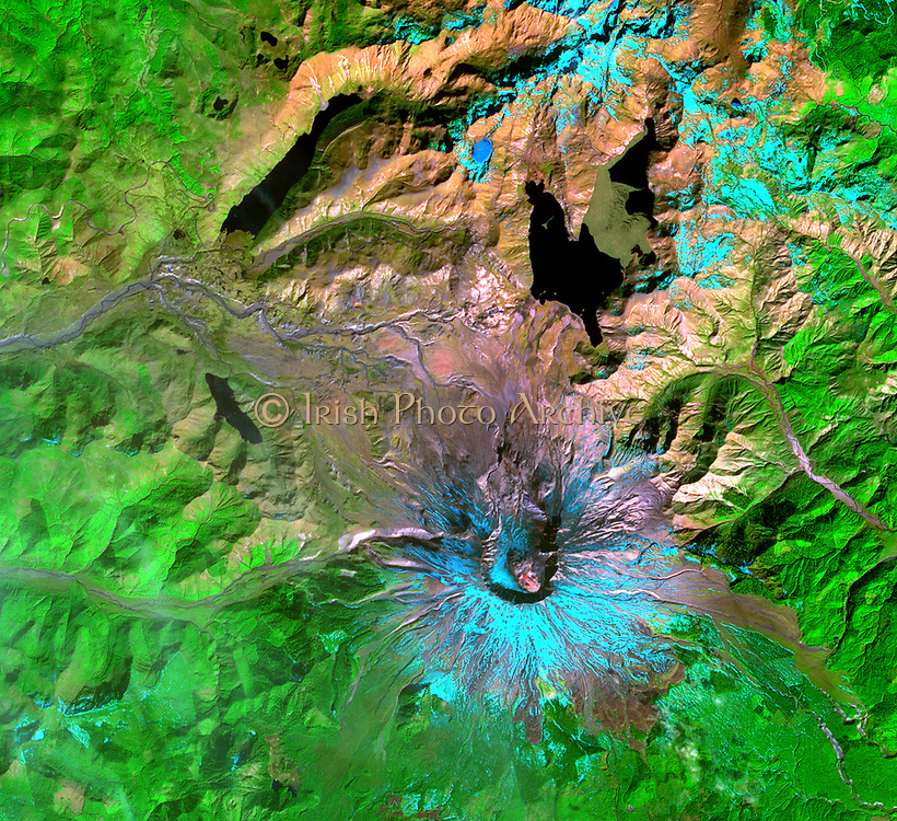 This Advanced Space borne Thermal Emission and Reflection Radiometer (ASTER) image of Mount St. Helens was captured one week after the March 8, 2005, ash and steam eruption, the latest activity since the volcano's reawakening in September 2004. The new lava dome in the southeast part of the crater is clearly visible, highlighted by red areas where ASTER's infrared channels detected hot spots from incandescent lava