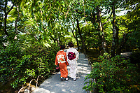 Two women in a garden in Kyoto, Japan.