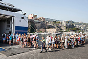 03 August 2017, Sorrento Italy - Tourists in a row on the pier of the port of Sorrento, on departure with the ferry-boat to Capri Island.