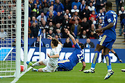 Leicester City forward Leonardo Ulloa slides home the third goal 3-0 during the Barclays Premier League match between Leicester City and Swansea City at the King Power Stadium, Leicester, England on 24 April 2016. Photo by Alan Franklin.
