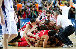 Players of Turkey celebrate during the second semifinal basketball match between National teams of Serbia and Turkey at 2010 FIBA World Championships on September 11, 2010 at the Sinan Erdem Dome in Istanbul, Turkey. Turkey defeated Serbia 83 - 82 and qualified to finals.  (Photo By Vid Ponikvar / Sportida.com)