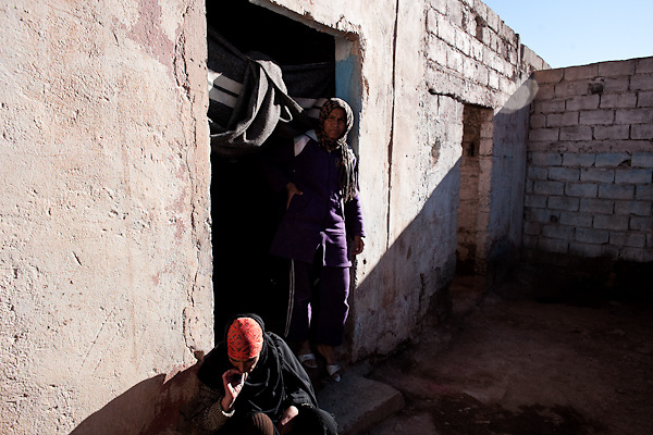 """Maria (left), 44 years old, and Kadija, age 28, are two sex workers who live in an old souk, Tamsult, that had just gone out of business in the '80s, at 1200 mt of altitude. This desolated place is known by all as the crossroads for sex. A group of sex workers occupy the walled and abandoned boutiques. Most of the whores, in the maroccan mountains, live around souks, the main places for any kind of business..January 2010, Tamsult, Anti-Atlas mountains, Morocco.....The misery of a square bare, dirt, dotted with broken glass and cans, brick structures close the doors of old shops, stray dogs and the ghosts of women who inhabit it. Are Taidit, are """"bitches"""", are prostitutes and are the renters of an old souk abandoned at 1200 meters in the heart of the Anti-Atlas Mountains of Morocco. The time when the market was full of merchants and sellers gave place to the vendors of their own bodies...To protect the identities of the recorded subjects names are fictional."""