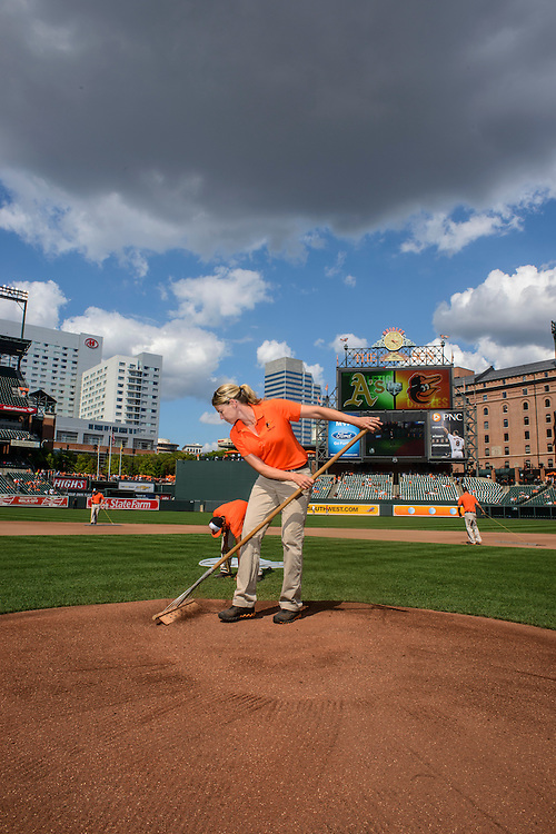 Photo by Matt Roth<br /> Assignment ID: 30146796A<br /> <br /> Nicole McFadyen, head groundskeeper for the Baltimore Orioles, dresses the Camden Yards mound before the start of the Orioles' home game against the Oakland Athletics in Baltimore, Maryland on Saturday, August 24, 2013. McFayden, who's held her position for seven years, is one of two female head groundskeepers in the Major Leagues.