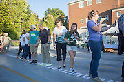 Jenny Hall-Jones walks with other participants in the BobcaThon cake walk to break a world record for the largest cake walk on October 5, 2016.