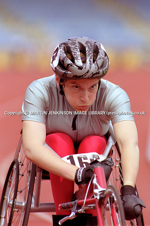 Female wheelchair racer lines up at the start of a race.