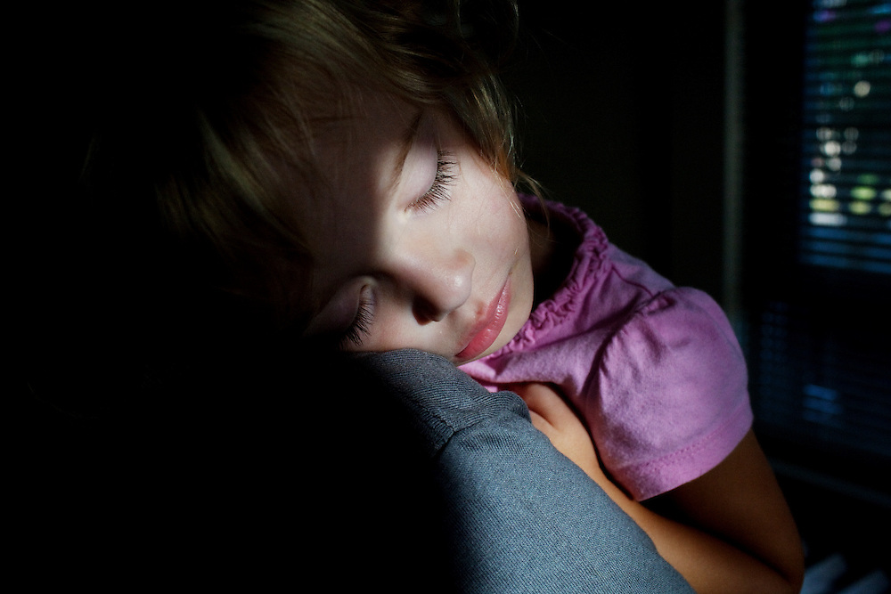 Madelyn Avery Eich, 2, sleeps on her mother Melissa's shoulder on the afternoon of Saturday, September 11, 2010 in their home in Norfolk, Virginia.