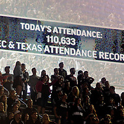 A sign displays the attendance as fans watch on during the second half of an NCAA college football game between Texas A&M and Mississippi in College Station, Texas, Saturday, Oct. 11, 2014. No. 3 Mississippi won 35-20. (Photo/Thomas Graning)