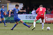 Connor Smith of AFC Wimbledon gets to the ball before Tom Davies of Accrington Stanley FC during the Sky Bet League 2 match between AFC Wimbledon and Accrington Stanley at the Cherry Red Records Stadium, Kingston, England on 5 March 2016. Photo by Stuart Butcher.