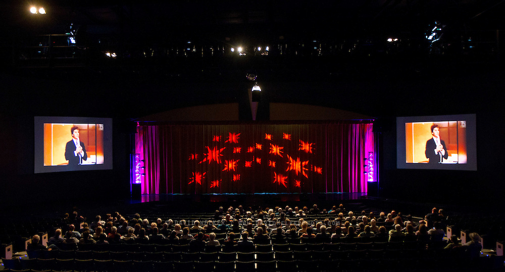 BRANSON, MO - APRIL 18: A crowd watches a tribute to Dick Clark during the Legends Live In Concert show at Dick Clark's American Bandstand Theater after to a candlelight vigil and performance in honor of Dick Clark on April 18, 2012 in Branson, Missouri.  (Photo by David Welker/Getty Images)*** Local Caption ***