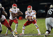 Kansas City Chiefs quarterback Alex Smith (11) fakes a handoff to Kansas City Chiefs running back Jamaal Charles (25) during the NFL week 12 regular season football game against the Oakland Raiders on Thursday, Nov. 20, 2014 in Oakland, Calif. The Raiders won their first game of the season 24-20. ©Paul Anthony Spinelli