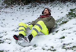 © Licensed to London News Pictures. 18/03/2018. Bristol, UK. People enjoy the snow in St Andrew's Park, Bristol, with a variety of sledges, some improvised, during a cold weather dubbed the 'mini beast from the east', the second spell of snow and freezing weather to hit the UK in March. Photo credit: Simon Chapman/LNP