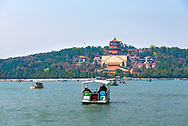 Beijing, China--April 4, 2016. Tourists take out paddle boats on the Kunming Lake on the grounds of the Summer Palace. Editorial Use Only.