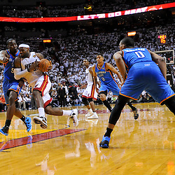 Jun 17, 2012; Miam, FL, USA; Miami Heat small forward LeBron James (6) drives past Oklahoma City Thunder center Kendrick Perkins (5) during the fourth quarter in game three in the 2012 NBA Finals at the American Airlines Arena. Miami won 91-85. Mandatory Credit: Derick E. Hingle-US PRESSWIRE