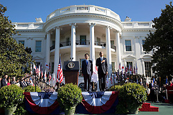 President Barack Obama and Prime Minister Shinzo Abe of Japan listen to the U.S. national anthem during the State Arrival ceremony on the South Lawn of the White House, April 28, 2015. (Official White House Photo by Pete Souza)<br /> <br /> This official White House photograph is being made available only for publication by news organizations and/or for personal use printing by the subject(s) of the photograph. The photograph may not be manipulated in any way and may not be used in commercial or political materials, advertisements, emails, products, promotions that in any way suggests approval or endorsement of the President, the First Family, or the White House.