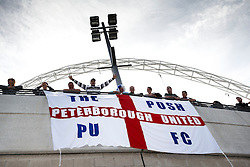 *CAPTION CORRECTION* - Peterborough fans hang a banner outside the stadium before the match- Photo mandatory by-line: Rogan Thomson/JMP - 07966 386802 - 30/03/2014 - SPORT - FOOTBALL - Wembley Stadium, London - Chesterfield FC v Peterborough United - Johnstone's Paint Trophy Final.