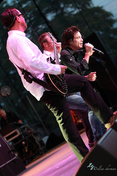 "INXS featuring Pat Monahan singing ""Beautiful Girl"" performs during their ""Original Sin"" tour at the Chateau Ste Michelle Winery in Seattle, Washington"