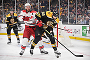 BOSTON, MA - MAY 09: Boston Bruins defenseman Zdeno Chara (33) and Carolina Hurricanes center Jordan Staal (11) battle for the loose puck. During Game 1 of the Eastern Conference Finals featuring the Boston Bruins against the Carolina Hurricanes on May 09, 2019 at TD Garden in Boston, MA. (Photo by Michael Tureski/Icon Sportswire)