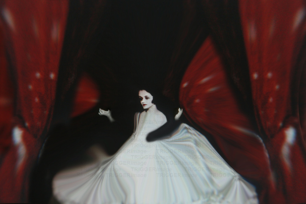A distorted woman in a white dress