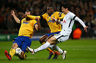 Giorgio Chiellini and  Blaise Matuidi of Juventus challenge Son Heung-Min of Tottenham during the UEFA Champions League match between Tottenham Hotspur and Juventus at Wembley Stadium in London. 07 Mar 2018