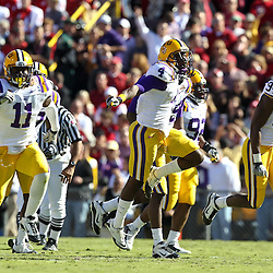 November 6, 2010; Baton Rouge, LA, USA;  LSU Tigers players LSU Tigers cornerback Jai Eugene (4), linebacker Kelvin Sheppard (11) and \defensive end Kendrick Adams (94) celebrates following a interception during the first half against the Alabama Crimson Tide at Tiger Stadium.  Mandatory Credit: Derick E. Hingle