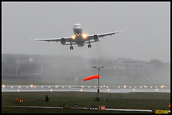 A plane takes off despite heavy rain and strong winds at Heathrow's Terminal 5.<br /> Christmas travellers leave for their festive holidays at Heathrow Airport. Monday, 23rd December 2013. Picture by Ben Stevens / i-Images