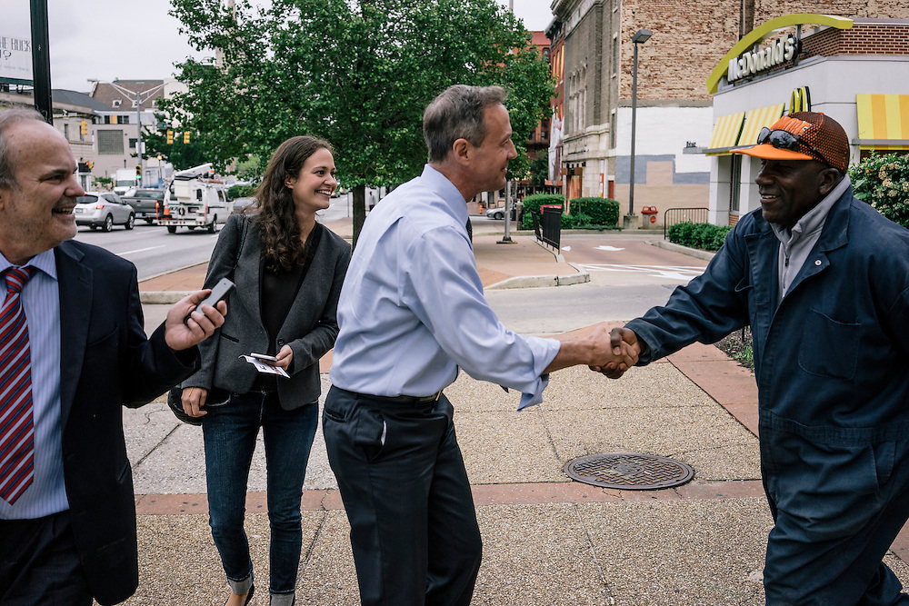 Former Maryland Governor Martin O'Malley greets a Baltimore resident on Thursday, May 21, 2015. O'Malley is considering a run for President of the United States.
