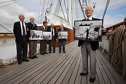 © Licensed to London News Pictures. 18/09/2013. London, UK. Captain Gwilym Williams, 98 (R), Sid Hunt, 89 (L), Leslie Taylor, 89 (2L), Don Staddon, 88 (3L), Derek Ings, 88 (3R) and Stanley Mayes, 88 (2R) all World War Two veterans of the Merchant Navy, hold new Royal Mail stamps showing scenes from World War Two Atlantic and Arctic convoys during their launch at the Cutty Sark in Greenwich, London, today (18/09/2013). The stamps, issued along with others depicting famous merchant ships including the Cutty Sark, are available from the 19th of September 2013. Photo credit: Matt Cetti-Roberts/LNP
