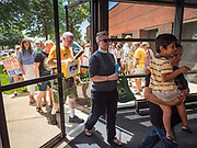 02 JULY 2019 - DES MOINES, IOWA: People file into the office building where Rep. Cindy Axne's (D-IA) office is in Des Moines. About 150 people came to Congresswoman Axne's office Tuesday to protest the treatment of migrant children detained by the US Border Patrol along the US/Mexico border. Axne was not in the office, but a member of Axne's staff took notes and promised to pass people's concerns on to the Congresswoman. Similar protests were held at other congressional offices and Immigration and Customs Enforcement (ICE) detention facilities across the country.          PHOTO BY JACK KURTZ