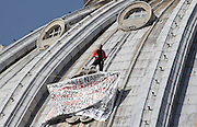 March 30, 2014 - Vatican City State (Holy See) - <br /> <br /> Man Stages Protest On St Peter's Dome In Vatican<br /> <br /> MARCELLO DE FINIZIO rose for the fouth time on the dome of St. Peters at the Vatican in protest against italian and european laws that would harm businesses. He spent the night on the dome and does not intend to get off asking help to the italain president, the italian prime minister and the Pope.<br /> ©Exclusivepix