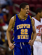 Coppin State guard Tywain McKee reacts after scoring 2 of his game high 33 points during the champion ship game of the 2008 MEAC Basketball Tournament at the RBC Center in Raleigh, North Carolina.  Coppin beat Morgan State 62-60 at the buzzer.  March 15, 2008  (Photo by Mark W. Sutton)