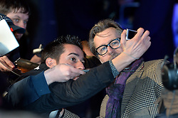 A fan takes a selfie with Gary Oldman at the RoboCop World Premiere at The BFI IMAX in London,UK.<br /> Wednesday, 5th February 2014. Picture by Ben Stevens / i-Images