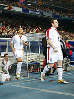Fotball<br /> Privatlandskamp<br /> Spania v England<br /> 17. november 2004<br /> Foto: Digitalsport<br /> NORWAY ONLY<br /> England's Wayne Rooney is followed out of the tunnel at the start of the match by team mates Rio Ferdinand and Gary Neville.