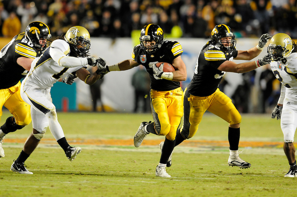 January 5, 2010: Running back Brandon Wegher of the Iowa Hawkeyes tries to elude defensive back Morgan Burnett of the Georgia Tech Yellow Jackets during the NCAA football game between the Georgia Tech Yellow Jackets and the Iowa Hawkeyes in the Orange Bowl at LandShark Stadium in Miami Gardens, Florida. The Hawkeyes defeated the Yellow Jackets 24-14.
