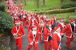 Over 1600 Santa's take part in Scotland's fundraising Santa's run, walk and stroll around Edinburgh's West Prices Street Gardens, raising money to grant the Wishes of Children for When You Wish Upon A Star. Sunday 11th December 2016. (c) Brian Anderson | Edinburgh Elite media
